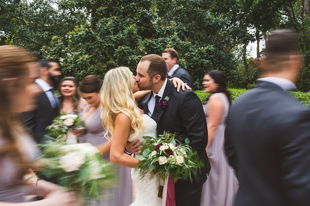 bride and groom kissing in crowd