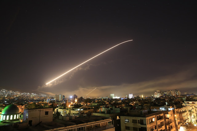 Image Attribute: The Damascus sky lights up with missile fire as the U.S. launches an attack on Syria targeting different parts of the capital early April 14, 2018, in retaliation for the country's alleged use of chemical weapons. / Source: Hassan Ammar / AP