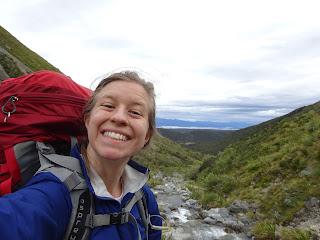 author posing for selfie on mountain ridge