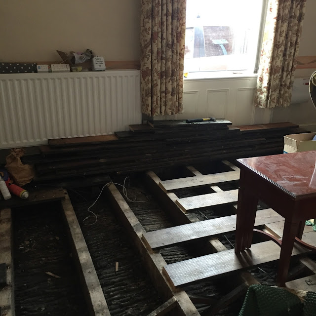 lifting up old floorboards