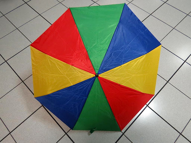 Multicolor umbrella on a square-tiled floor, Livorno
