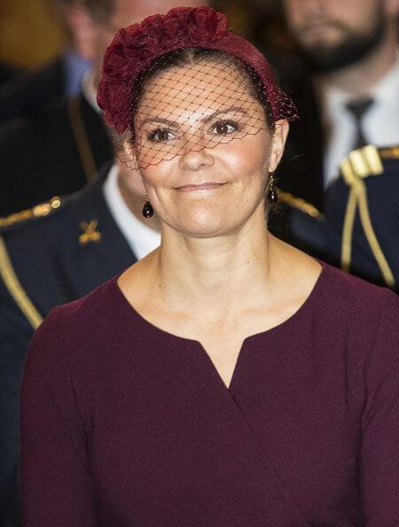 Crown Princess Victoria wore Camilla Thulin montana dress. The Crown Princess wore a burgundy dress by Camilla Thulin