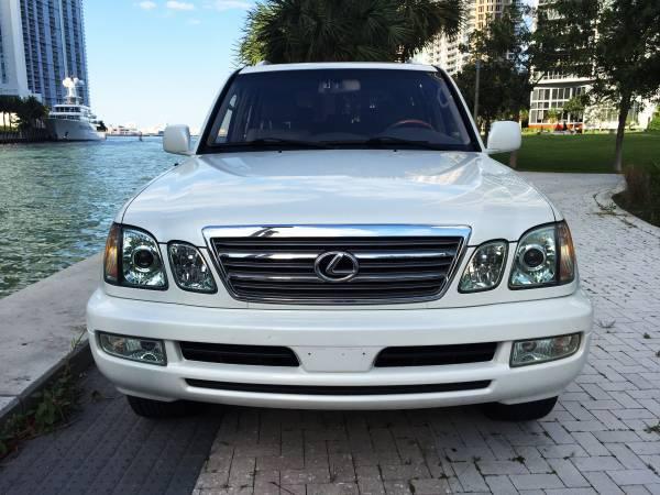 https://2.bp.blogspot.com/-uLrt-BTo3-Q/VYRk6FQNYKI/AAAAAAABAkE/4IQXAYEyn3Y/s1600/2003-Lexus-LX470-front.jpg