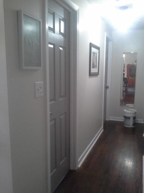 Hallway painted white trim grey doors