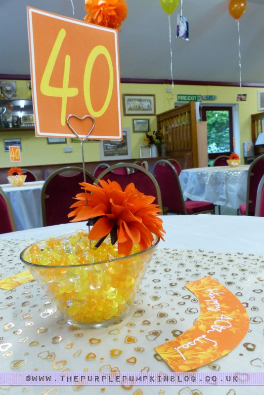 Orange yellow 40th birthday party decorations for Orange centerpieces for tables