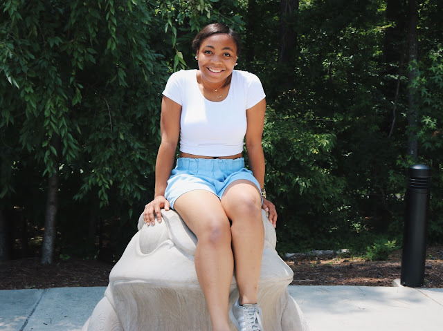 Miss Lauren Alston wearing chambray shorts and white crop top