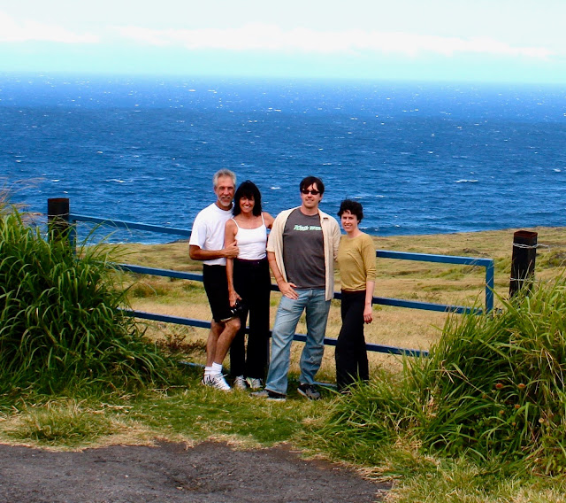 The four of us standing in front of a Pacific ocean view