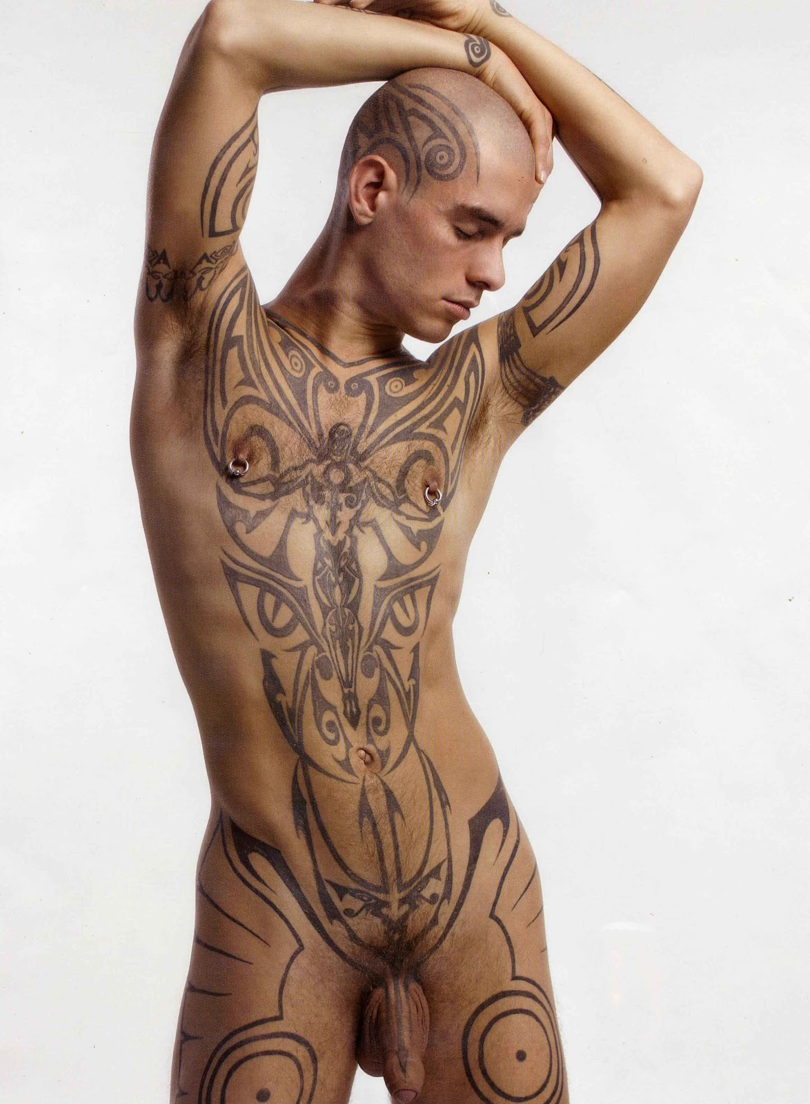 Tattooed nude man with full boner