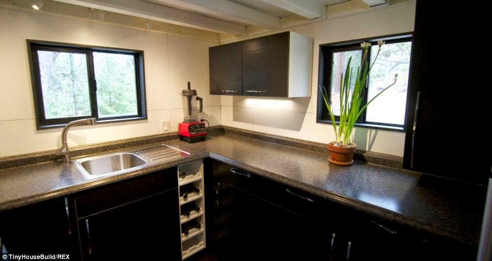 The kitchen is smaller but provides everything they need.  - This Couple Got Out Of The Rat Race. And Built This Tiny Home For $33K.