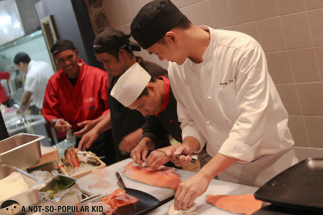 Cutting of the fresh salmon in Ichiba