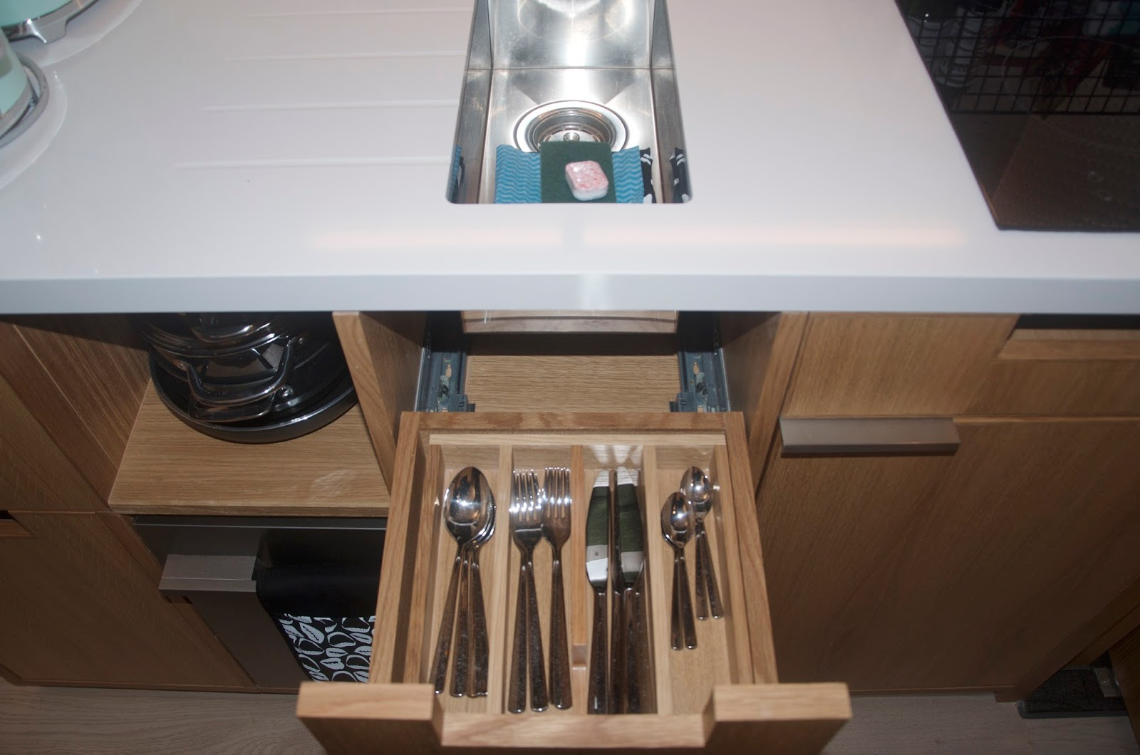 kitchenette with silverware and utensils