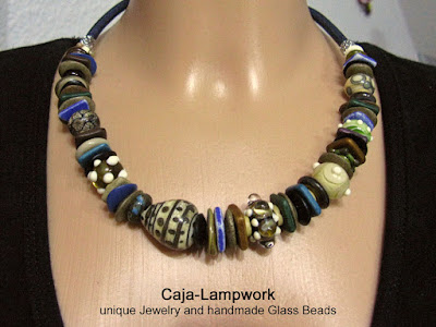 Glass jewelery in warm earthy colors
