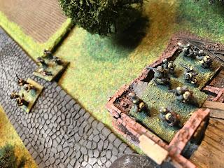 German riflemen take aim at the advancing British soldiers