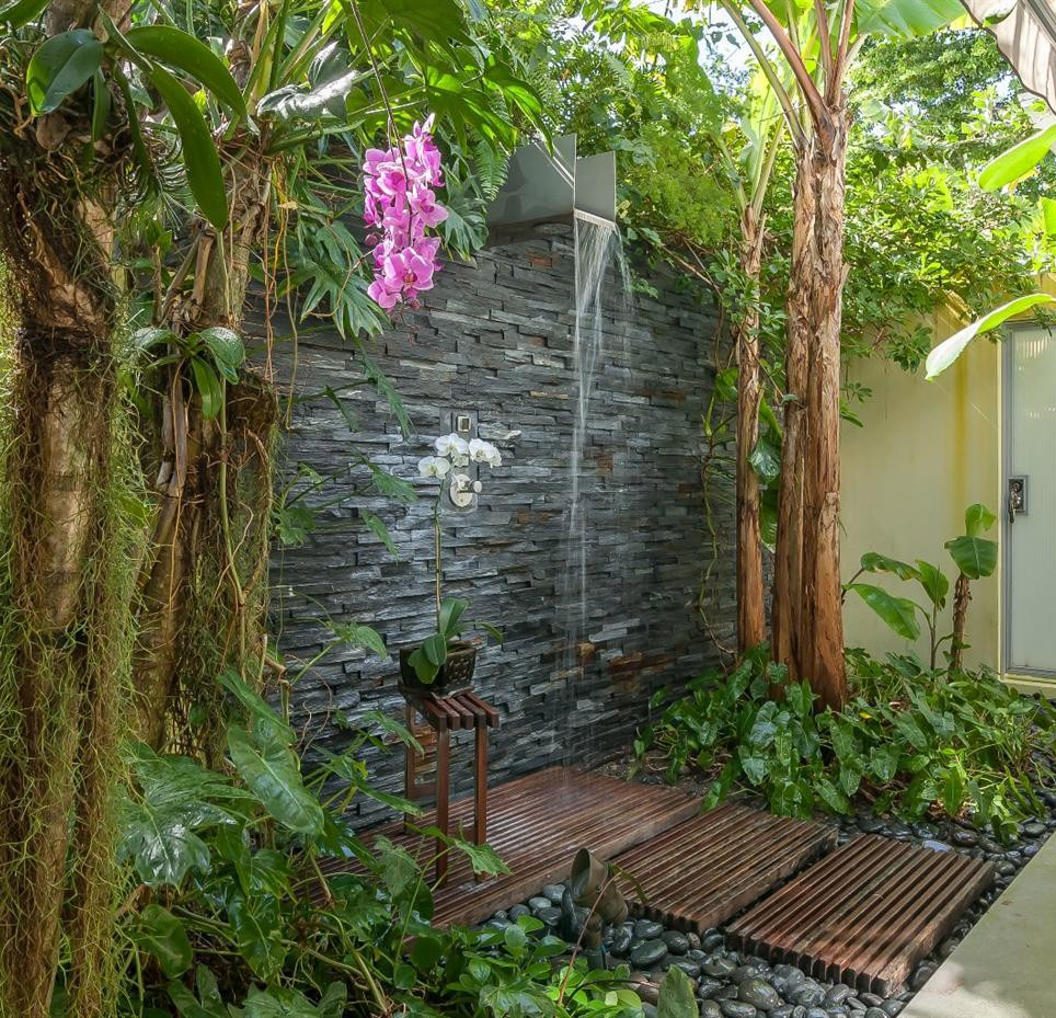 stone-wall-with-flowers-garden-shower-design