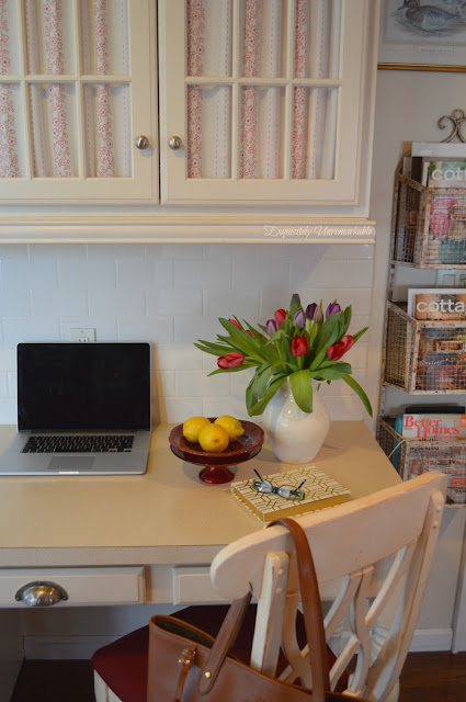 Kitchen Desk with fabric covered glass cabinets above it