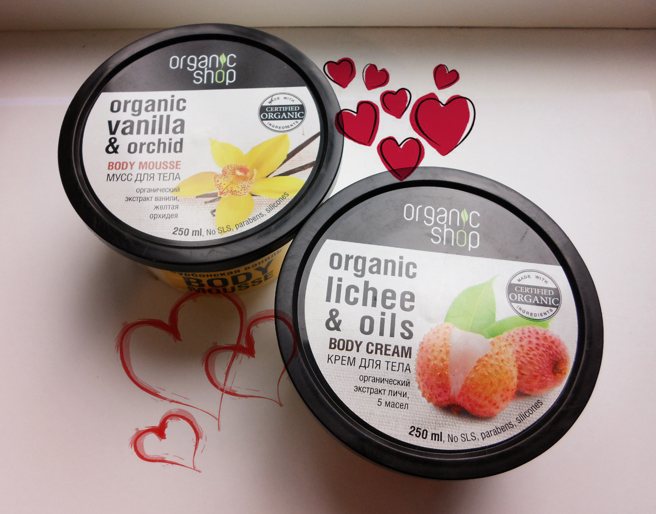 oa close-up picture of two skincare products by organic shop brand close to the window