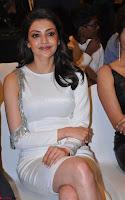 Beautiful Smiling Kajal Aggarwal in Creamy White Gown at MLA Telugu Movie Success Meet ~ .com Exclusive Pics 004.jpg