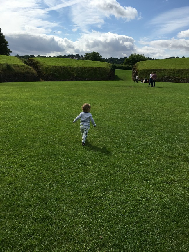 Trains-romans-and-bikes-toddler-at-caerleon-roman-amphitheatre
