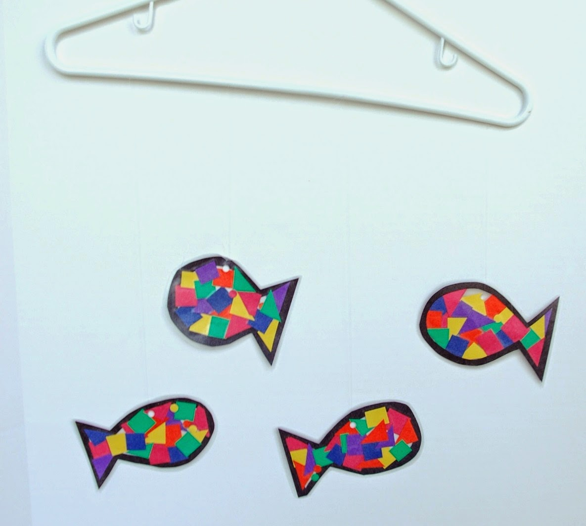 Rainbow Fish Craft, with clothes hanger ready for ocean background