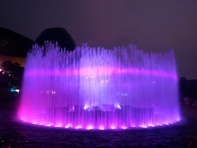 Fountain with light projections during Symbio show, Ocean Park