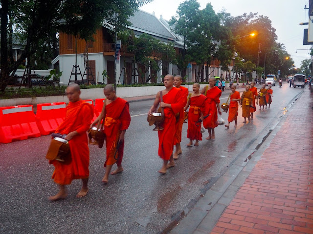 Monks collecting food donations early in the morning in Luang Prabang, Laos
