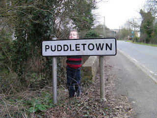 town sign puddletown dorset and blue vinny pub