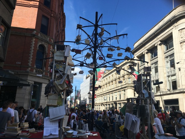City-Of-The-Unexpected-Cardiff-Celebrates-Roald-Dahl-crowds-and-books-hanging-from-a-lamp-post