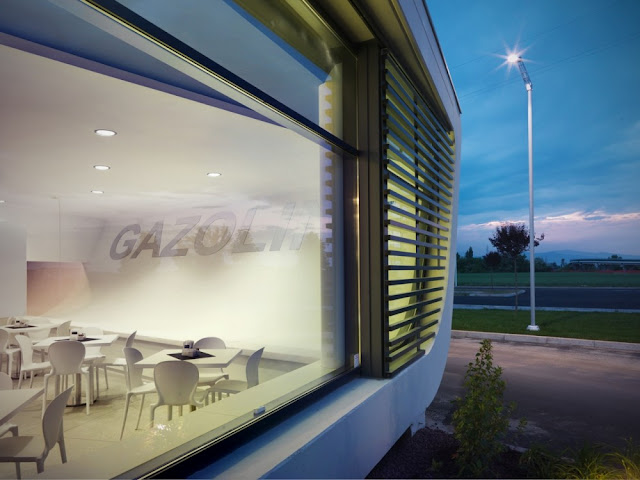 Photo of window and black blinds at Gazoline Petrol Station by Damilano Studio Architects