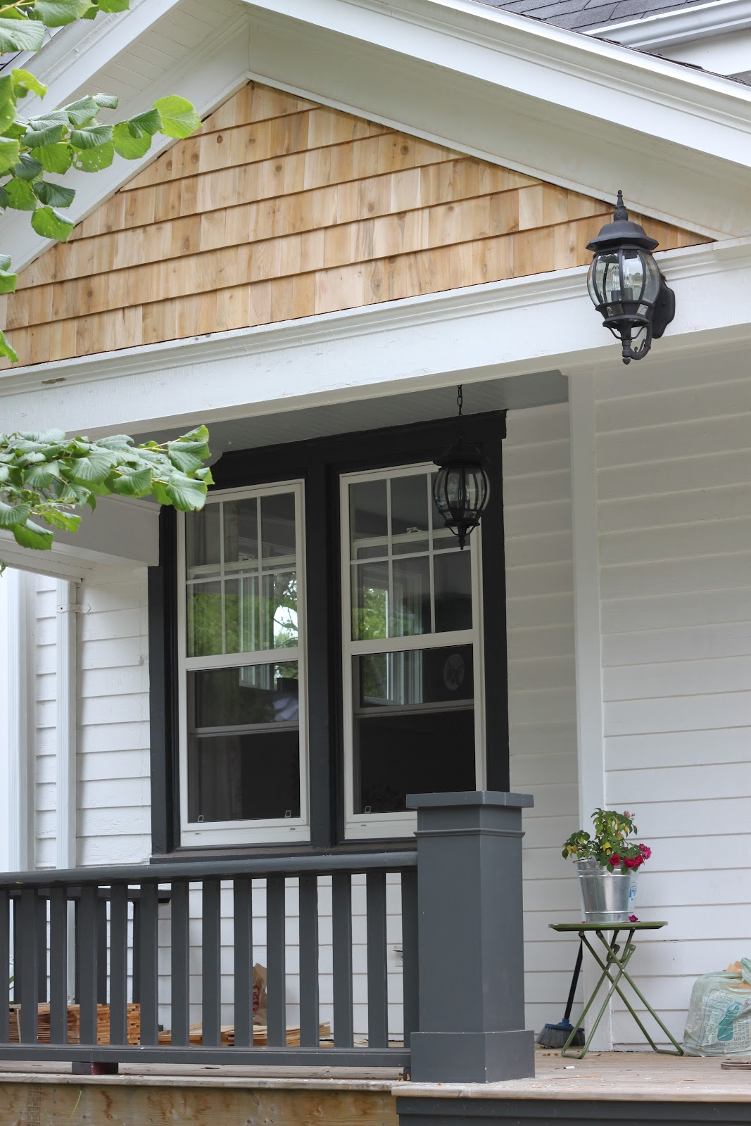 Modern jane porch gable update - White house with grey trim ...