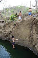 jumping off a big rock into a river