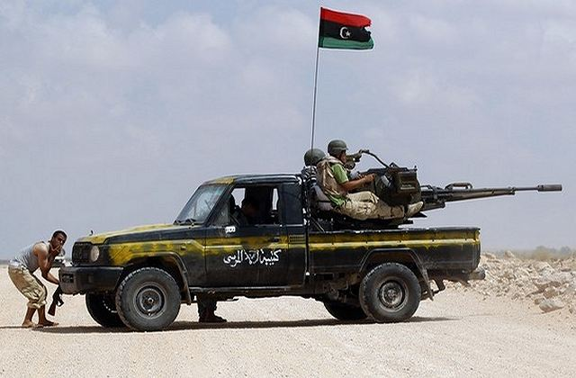 Anti-Gaddafi_fighters_fire_weapons_at_Ga