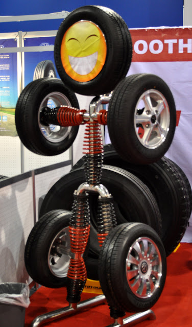 just a car guy clever tire and rim display at sema. Black Bedroom Furniture Sets. Home Design Ideas