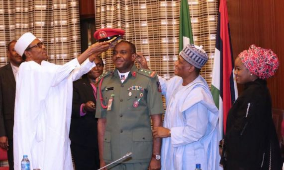 President Buhari Decorates His ADC
