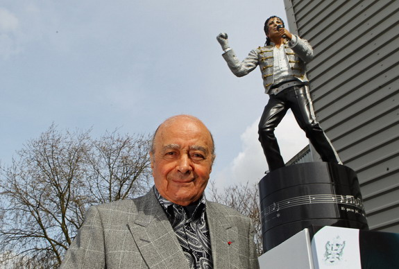 Then Fulham chairman Mohamed Al-Fayed unveils a statue of pop legend Michael Jackson in 2011