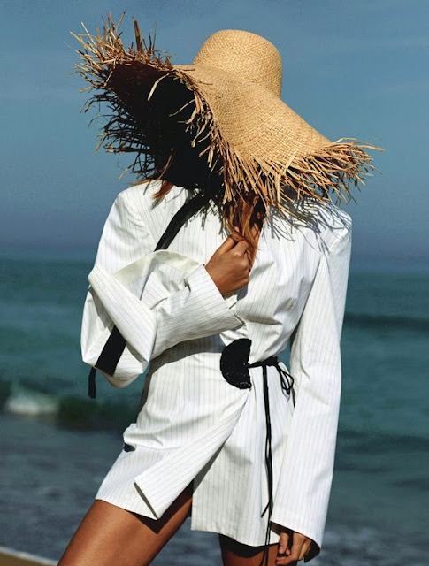 Straw hat with oversized blazer for summer chic