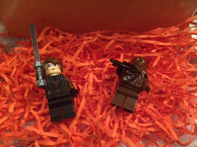 Box containing two star wars mini figures