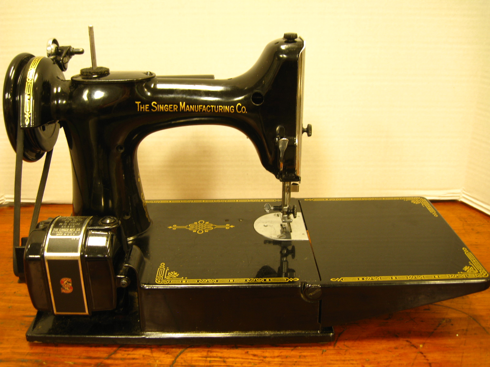 This is a great Singer Sewing machine with case, pedal, and vintage Singer  manual.