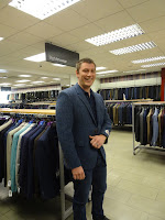 man being fitted for suit in glasgow slaters