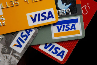 Photo of Visa credit cards.