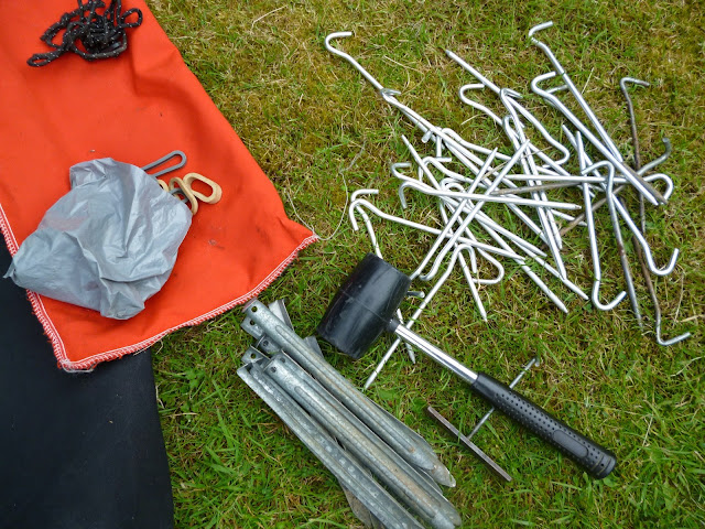 tent pegs and mallet on the grass