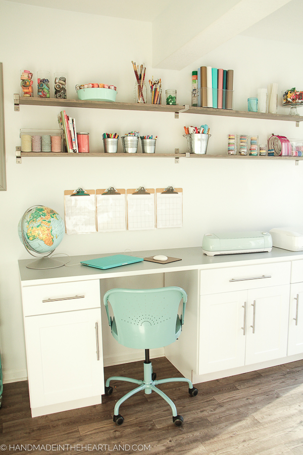 All the details for this white and aqua craft room, so inspiring!