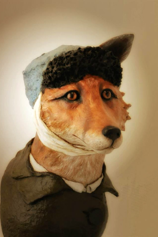 paper mache fox dressed in clothing