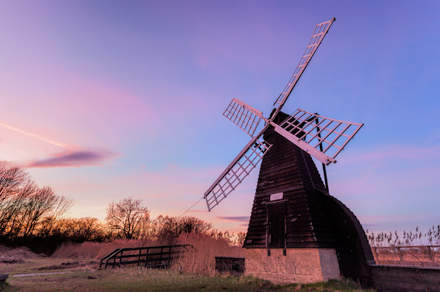 Sunset colours over the wind pump at Wicken Fen Nature Reserve