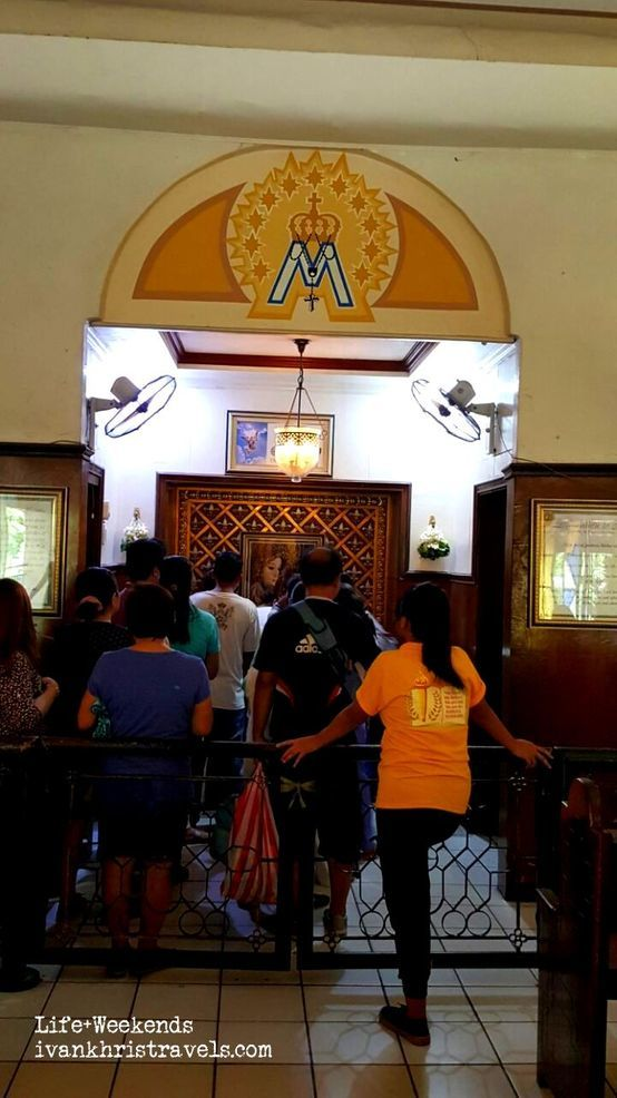 Lining up to touch the statue of Our Lady of Manaoag