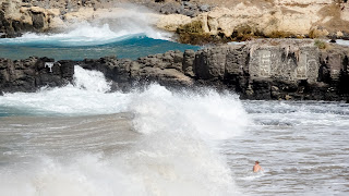 Person gets hit by a wave in Cape Verde