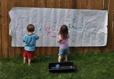 Have kids paint on a large sheet of paper hung onto the fence outside