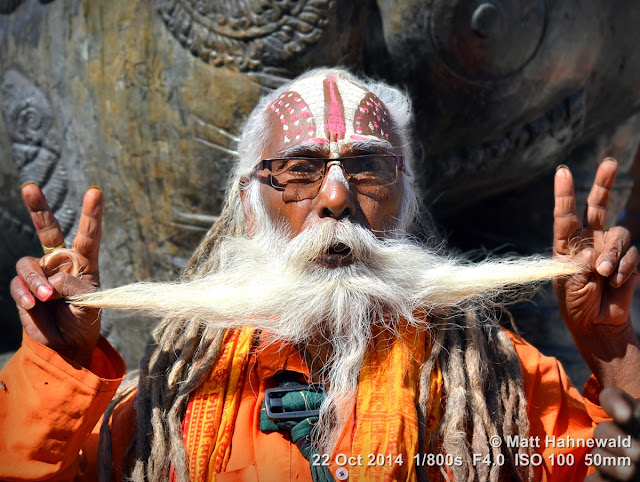 people; closeup; street portrait; headshot; Nepal; Kathmandu; sadhu; Hinduism; holy man; religious ascetic; yogī; mokṣa; double V sign