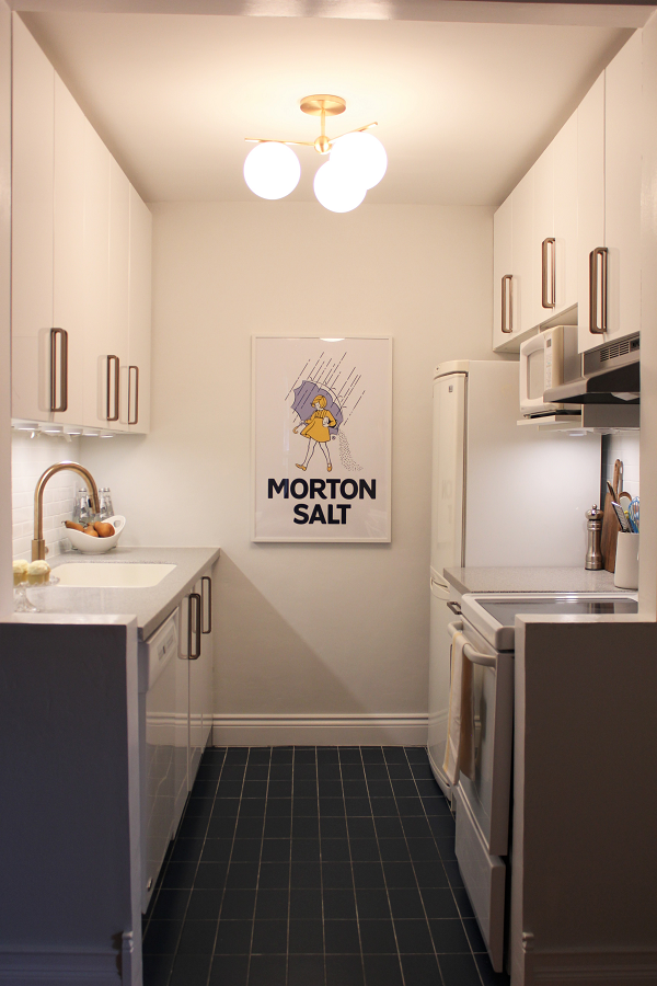 White kitchen with brass accents and Morton Salt Poster
