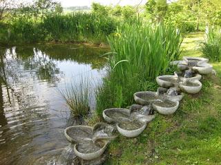 Water traveling through stream-side sculpture, Loch Arthur Creamery and Farm Shop, Beeswing, Scotland