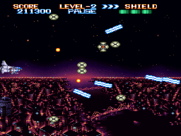 The main spaceship flies through a level above a cityscape at night.